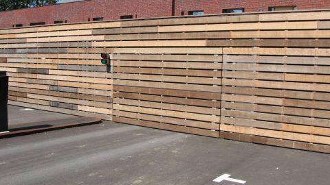 Design deur - Gevelelementen - architectonisch ontwerp gelijk met de gevel, houtbekleding