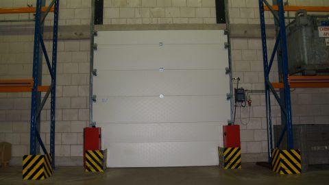 Sectionaaldeur; brandwerende en vloeistofhoudende insluitpoort